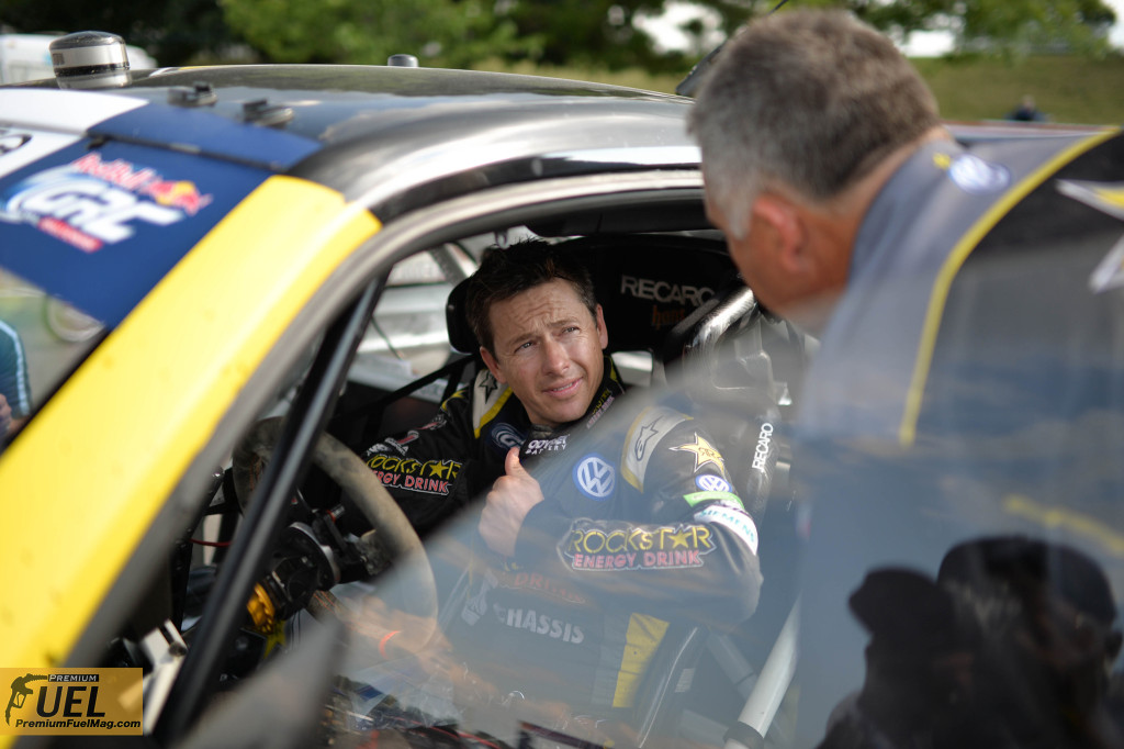 Tanner Foust packing ice packs into his jumpsuit to keep cool in the crazy heat